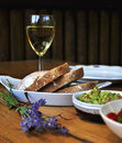 Wine glass and brad bread lavender on the table Stock Image
