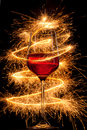 Wine in glass with burning sparklers Stock Image