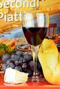 Wine glass cheese grapes and bread Stock Photo