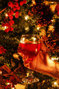 Wine glass and christmas tree a hand holding a of in front of a Stock Photography