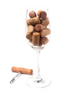 Wine glass filled with wine corks Royalty Free Stock Photo