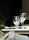 Wine glass and fine dining outdoor table top Stock Photos