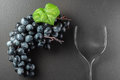 Wine glass made of forks and grape on black Royalty Free Stock Photo