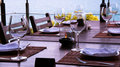 Wine glass and seaside restaurant Stock Image
