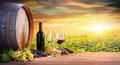 Wine Glasses And Bottle With Barrel In Vineyard Royalty Free Stock Photo