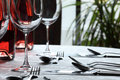 Wine Glasses and cutlery in restaurant Stock Photo