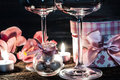Wine glasses, gift and candles for romantic evening Royalty Free Stock Photo