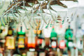 Wine glasses hanging from metal beams on defocused background. S Royalty Free Stock Photo