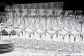 Wine glasses with plates on the table. Black background. Royalty Free Stock Photo