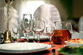 Wine glasses in a restaurant table setting fruit Stock Photography