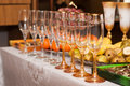 Wine glasses on the table serving fruit and salads Stock Images