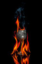 Wine goblet with fire flames on black background Stock Photos