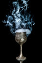 Wine goblet with smoke on black background Royalty Free Stock Photo