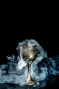 Wine goblet with smoke on black background Royalty Free Stock Images