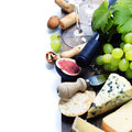 Wine grape and cheese over white Stock Images