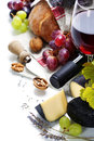 Wine grape and cheese over white Royalty Free Stock Photo