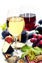 Wine grape and cheese over white Stock Photo
