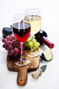 Wine grape and cheese over white Stock Image