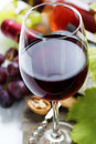 Wine and grape on wooden background Royalty Free Stock Images