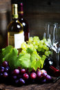 Wine and grape on wooden background Royalty Free Stock Photos