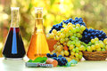 Wine and grapes in the bottles quality white red red white on table Royalty Free Stock Image