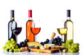 Wine grapes and cheese on white Royalty Free Stock Photo