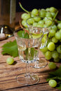 Wine and grapes old style still life with white Stock Image