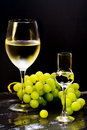 Wine and grappa glass with grapes bunch Royalty Free Stock Images
