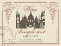 Wine label with the old town and a bunch of grapes Royalty Free Stock Photography