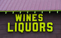 Wine and liquor store building sign on small town Stock Photo