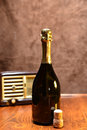 Wine and music a retro style picture with a bottle of a cork an old radio on the background Stock Photography