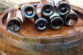 Wine over wood barrel Royalty Free Stock Photos