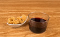 Wine and pork rinds Stock Photo