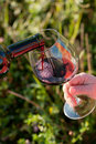 Wine pouring from bottle, outdoor Stock Photo
