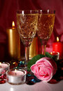 Wine and rose in a glass burning candles Royalty Free Stock Images