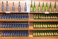 Wine shelves in shop Stock Photos