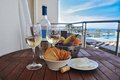 Wine with snack on a background of the sea closeup view Royalty Free Stock Photography