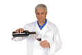 Wine steward older sommelier pouring red into a glass isolated on white Royalty Free Stock Photo