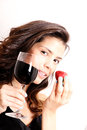 Wine and strawberry portrait of a beautiful latin woman eating a drinking Stock Photo