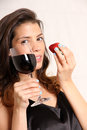Wine and strawberry portrait of a beautiful latin woman eating a drinking Royalty Free Stock Image