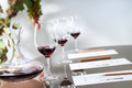 Wine tasting table set with decanter and glasses.
