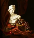 Wine traditions antiquity to modern times still life bust apollo grapes wine Stock Photography