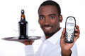 Wine waiter black showing a telephone Stock Image
