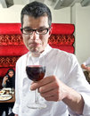Wine waiter savouring wine Stock Images
