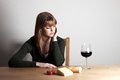 Wine young woman and a glass of Royalty Free Stock Photos