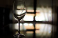 Wineglass backlit glass cup on a darkened room Royalty Free Stock Photo