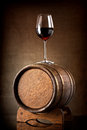 Wineglass and barrel red wine glass with wooden Royalty Free Stock Photo