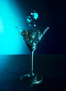 Wineglass with ice on the table Royalty Free Stock Images
