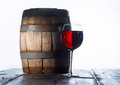 Wineglass and a old barrel Royalty Free Stock Photo