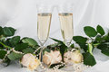 Wineglass, rose and gold rings on the dress Royalty Free Stock Photo